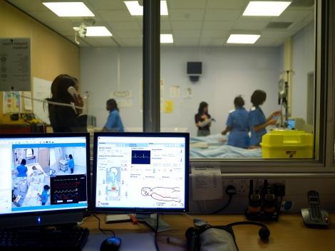 Postgraduate medicine students on a mock hospital ward